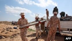 Military engineers of the U.N.-recognized Libyan Government of National Accord (GNA) arrive at the site where ammunition will be disposed in the Libyan capital Tripoli on October 12, 2020. (Photo by Mahmud TURKIA / AFP)