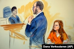 U.S. -- A courtroom sketch depicts Maria Butina, listening to Assistant U.S. Attorney Erik Kenerson as he speaks to Judge Deborah Robinson, left, during a hearing in federal court in Washington, July 18, 2018