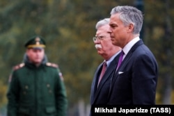 RUSSIA -- U.S. National Security Adviser John Bolton and U.S. Ambassador to Russia Jon Huntsman attend a wreath-laying ceremony at the Tomb of the Unknown Soldier by the Kremlin wall in Moscow, October 23, 2018