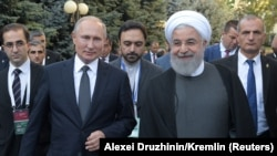 ARMENIA -- Russian President Vladimir Putin and Iranian President Hassan Rouhani arrive for a meeting on the sidelines of a session of the Supreme Eurasian Economic Council In Yerevan, Armenia. October 1, 2019.