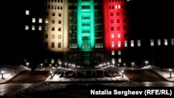 Moldova -- Lithuanian flag colors projected on the Parliament building in Chisinau to honour Lithuania's centenary.