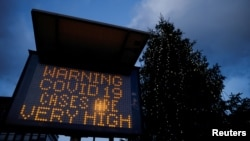 UK – An electronic sign displays information as the British government imposes a stricter tiered set of restrictions amid the coronavirus disease (COVID-19) pandemic, in London, Britain, December 20, 2020.