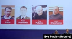 NETHERLANDS -- Russian nationals Igor Girkin, Sergey Dubinskiy and Oleg Pulatov, as well as Ukrainian Leonid Kharchenko, accused of downing of flight MH17, are shown on screen as international investigators present their latest findings in the case.
