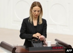 Turkey -- Turkish deputy Aylin Nazliaka has handcuffed herself to the podium in a protest against the constitutional reform aimed at strengthening the powers of the Turkish president during a debate at the Turkish Parliament in Ankara, January 19, 2017.