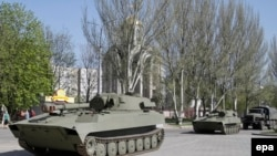 Ukraine -- Pro-Russian armored military vehicles ride in Donetsk, April 27, 2015