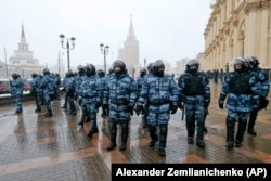 Riot police block off an area during a protest against the jailing of opposition leader Alexey Navalny in Moscow, Russia, on Jan. 31, 2021.