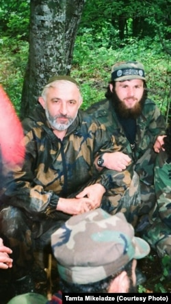 In this undated photo, Zelimkhan Khangoshvili (rear) is shown seated alongside Aslan Maskhadov (front) who served briefly as president of Chechnya in the 1990s.