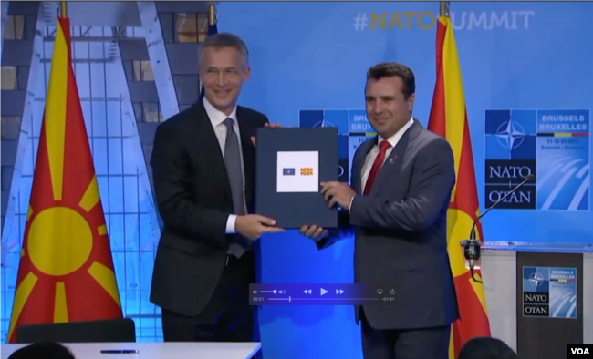 NATO Secretary General Jens Stoltenberg and North Macedonia's Prime Minister Zoran Zaev sign an accession protocol in Brussels.