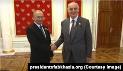 Russia -- Vladimir Putin meeting Aslan Bzhania, the leader of the Georgian breakaway territory of Abkhazia. June 24, 2020.