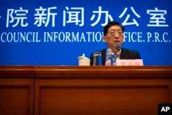 Zeng Yixin, Vice Minister of the Chinese National Health Commission, speaks at a press conference at the Information Office of the State Council in Beijing on Thursday, July 22, 2021. Mark Schiefelbein/AP
