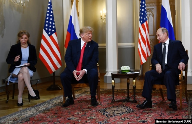 FINLAND -- Russian President Vladimir Putin (R) and U.S. President Donald Trump (2L) attend a meeting in Helsinki, July 16, 2018