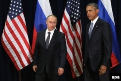 U.S. -- Russian President Vladimir Putin (L) and US President Barack Obama (R) pose for photographs before the start of a bilateral meeting at the United Nations headquarters in New York City, New York, USA, 28 September 2015.