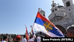 Montenegro -- Orthodox believer is carrying the Serbian flag in front of the Cathedral of the Resurrection of Christ in Podgorica, June 15, 2019.