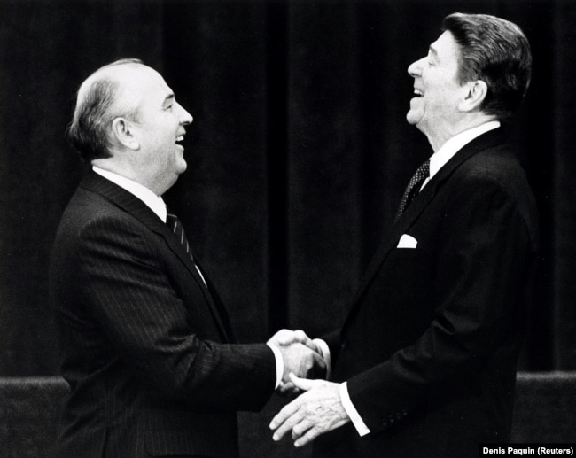 SWITZERLAND -- U.S. President Ronald Reagan (R) shakes hands at his first meeting with Soviet leader Mikhail Gorbachev to sign an arms treaty in Geneva, November 19, 1985
