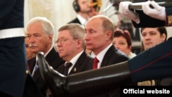 Alexandr Torshin next to Vladimir Putin at the state ceremony in the Kremlin, June 2011