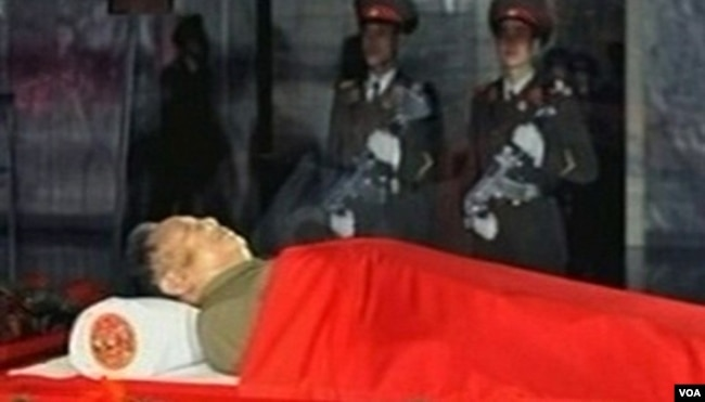 The body of North Korean leader Kim Jong Il is laid in a memorial palace in Pyongyang, North Korea, December 20, 2011