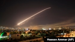 SYRIA – The Damascus sky lights up missile fire as the U.S. launches an attack on Syria targeting different parts of the capital early Saturday, April 14, 2018