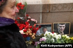 RUSSIA --An elderly woman lays flowers at the site where late opposition leader Boris Nemtsov was fatally shot on a bridge near the Kremli, in central Moscow, February 27, 2019