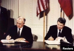 U.S. -- File photo of U.S. President Ronald Reagan (R) and Soviet President Mikhail Gorbachev the Intermediate-Range Nuclear Forces (INF) treaty at the White House, on December 8 1987