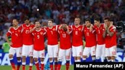 RUSSIA -- Russia national soccer team players react after the quarterfinal match between Russia and Croatia at the 2018 soccer World Cup in the Fisht Stadium, in Sochi, Russia, Saturday, July 7, 2018