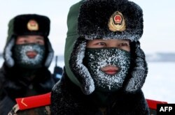 Chinese paramilitary police border guards train in the snow at Mohe County in China's northeast Heilongjiang province, China, on the border with Russia on December 12, 2016.