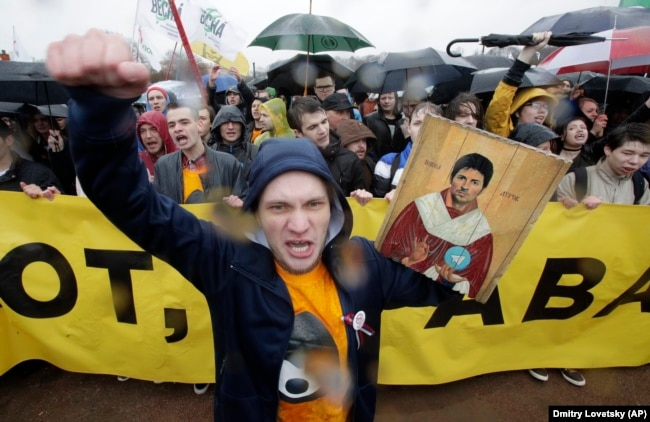 RUSSIA -- A man shouts while holding a portrait of messaging app Telegram co-founder Pavel Durov designed as an icon, to protest against the blocking of the app in Russia, during a May Day rally in St. Petersburg, May 1, 2018