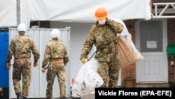 U.K. -- Army officers wearing combat uniform are seen carrying bags after removing what is believed to be part of the roof at the house of former Russian spy Sergei Skripal in Christie Miller Road in Salisbury, February 4, 2019