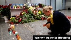 UKRAINE – Relatives of the flight crew members of the Ukraine International Airlines Boeing 737-800 plane that crashed in Iran, mourn at a memorial at the Boryspil International airport outside Kyiv, January 8, 2020