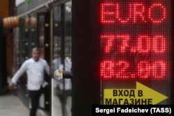Russia -- A digital board displaying currency exchange rates in Moscow, March 8, 2020
