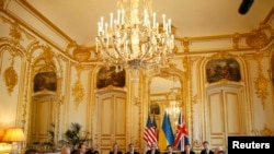 France -- US Secretary of State John Kerry (center) hosts the Budapest Memorandum Ministerial meeting with Ukrainian Foreign Minister Andriy Deshchytsya (3rd R) and British Foreign Secretary William Hague (2nd L) in Paris, March 5, 2014