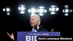 FILE PHOTO: U.S. Democratic presidential candidate Joe Biden speaks about reopening schools amid the coronavirus disease (COVID-19) pandemic, in Wilmington, Delaware, U.S., September 2, 2020.