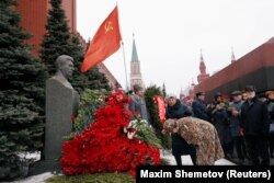 RUSSIA -- A woman bows her head to the bust of Soviet leader Joseph Stalin during a ceremony marking the 66th anniversary of his death, in Red Square, Moscow, Russia March 5, 2019