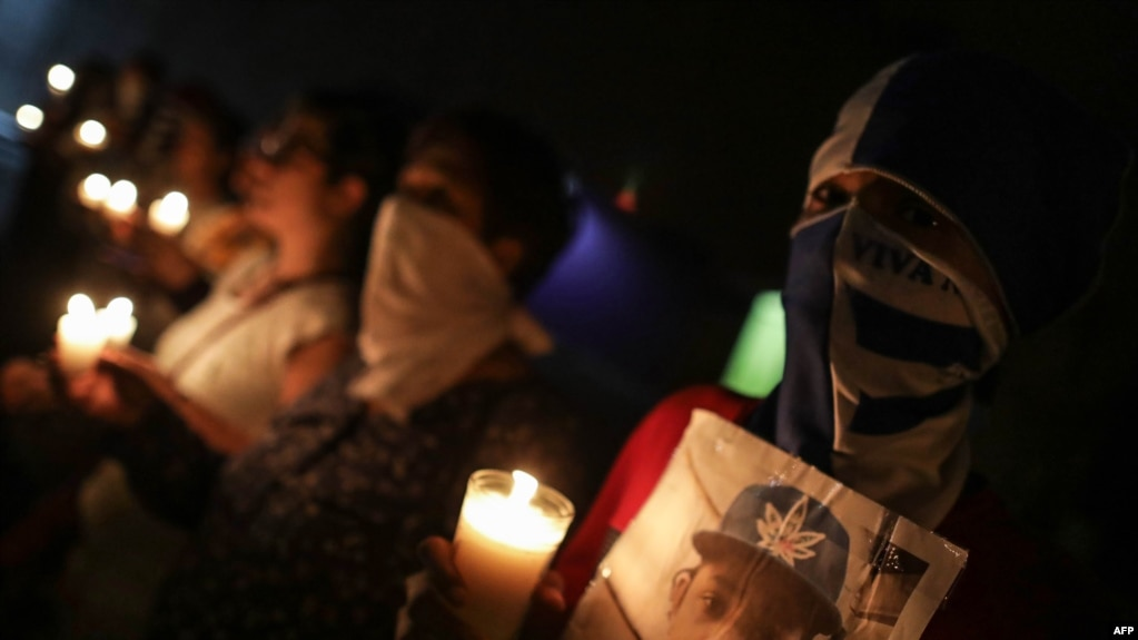 NICARAGUA – Anti-government demonstrators take part in a vigil to demand the release of political prisoners and justice for the victims of protests against President Daniel Ortega, outside the Metropolitan Cathedral of Managua on October 3, 2019.