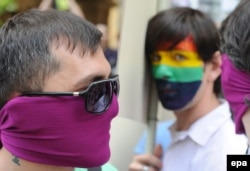 GEORGIA INTERNATIONAL DAY AGAINST HOMOPHOBIA -- Members of the LGBT (Lesbian, Gay, Bisexual and Transgender) Georgia community are seen during a small gay parade on the occasion of the International Day against Homophobia, in Tbilisi, Georgia, 17 May 2012.