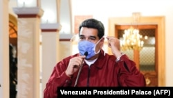 VENEZUELA -- Venezuelan President Nicolas Maduro wearing a face mask while speaking during a televised announcement over the global COVID-19 coronavirus pandemic, in Caracas, March 13, 2020.