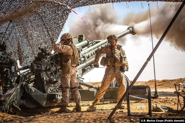 SYRIA - U.S. Marines with the 11th Marine Expeditionary Unit fire an M777 Howitzer during a fire mission in northern Syria as part of Operation Inherent Resolve, Mar. 24, 2017.
