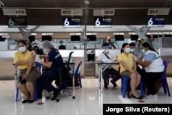 People get vaccinated against COVID-19 at Suvarnabhumi in Bangkok on April 28, 2021.