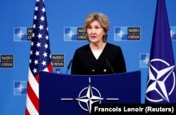 BELGIUM -- U.S. Ambassador to NATO Kay Bailey Hutchison briefs the media ahead of a NATO defence ministers meeting at the Alliance headquarters in Brussels, October 2, 2018
