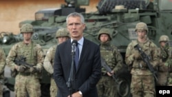 POLAND -- NATO Secretary-General Jens Stoltenberg delivers a statement after a meeting with soldiers of the Batallion Battle Group NATO near Orzysz, August 2017.