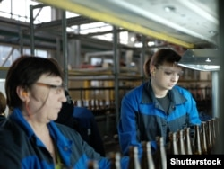 RUSSIA -- Tyumen; April; 21; 2018: Factory for the production of glass bottles. Women check glass bottles