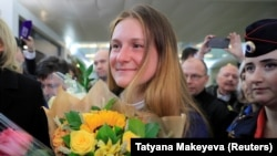 RUSSIA -- Convicted Russian agent Maria Butina, who was released from a Florida prison and then deported by U.S. immigration officials, holds flowers upon her arrival at Sheremetyevo International Airport outside Moscow, Russia October 26, 2019.