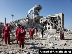 Yemen-- Red Crescent medics stand at the site of Saudi-led air strikes on a Houthi detention centre in Dhamar, September 1, 2019