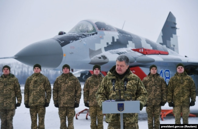 UKRAINE -- Ukraine's President Petro Poroshenko addresses servicemen of the 40th Tactical Aviation Brigade of the Ukrainian Armed Forces at an airbase in Vasylkiv near Kyiv, December 1, 2018.
