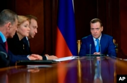 Russian Prime Minister Dmitry Medvedev leads a cabinet meeting, Moscow, Russia, April 9, 2018. Medvedev ordered his Cabinet to draw up measures to support the companies in the energy, metals and arms sectors that were sanctioned by the U.S. on April 6.