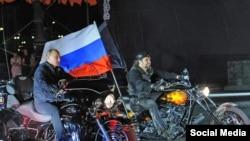 Russian President Vladimir Putin riding alongside the leader of the Night Wolves Alexander Zaltostanov aka the Surgeon