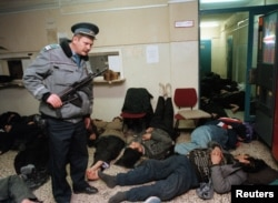 Hungary--Police guard Afghan refugees in Budapest police station on December 15, 1998.