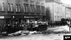 CZECHOSLOVAKIA -- A tank drives on a street during confrontations between demonstrators and the Warsaw Pact troops and tanks, August 1968