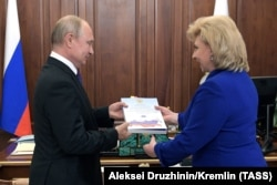 RUSSIA -- Russian Human Rights ombudsman Tatyana Moskalkova gives a report of her work to Russian President Vladimir Putin during their meeting at the Kremlin in Moscow, June 10, 2019