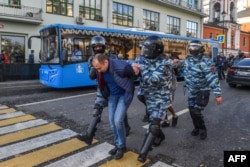 Russia -- special police forces detain a man after a rally urging fair elections in central Moscow on 10 Aug 2019