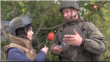Oleg Nitkin, official representative of the Donestk People's Militia, showing a reporter from the Russian Defense Ministry's TV Zvezda the remnant from a mortar shell allegedly used by Ukrainian forces in the country's east.